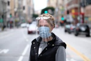 Woman wearing the Origami Face Shield. Photo credit: Helpful Engineering